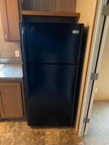 Frigidaire Refrigerator, Model FFTR1821QB3, in working condition