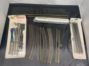 Assorted HO Scale train track, and partial locomotive
