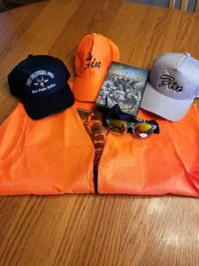 3 hats, Orange Vest, and a dvd