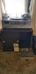 Cassette/ record player w/ speakers includes cabinet and cassettes