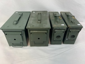 Four metal ammo cases