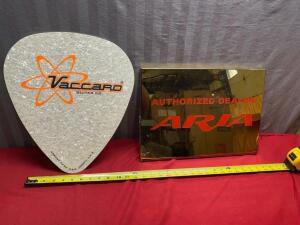 Vaccard Guitar Co. sign and Aria Authorized Dealer Sign