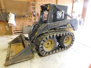 New Holland LS140 skid steer w/bucket – tracks- 900 hours
