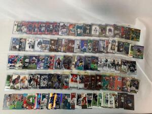 Lot of 100 Serial #'D Football cards including Faulk, Vick, Singletary, Woodson, Etc.